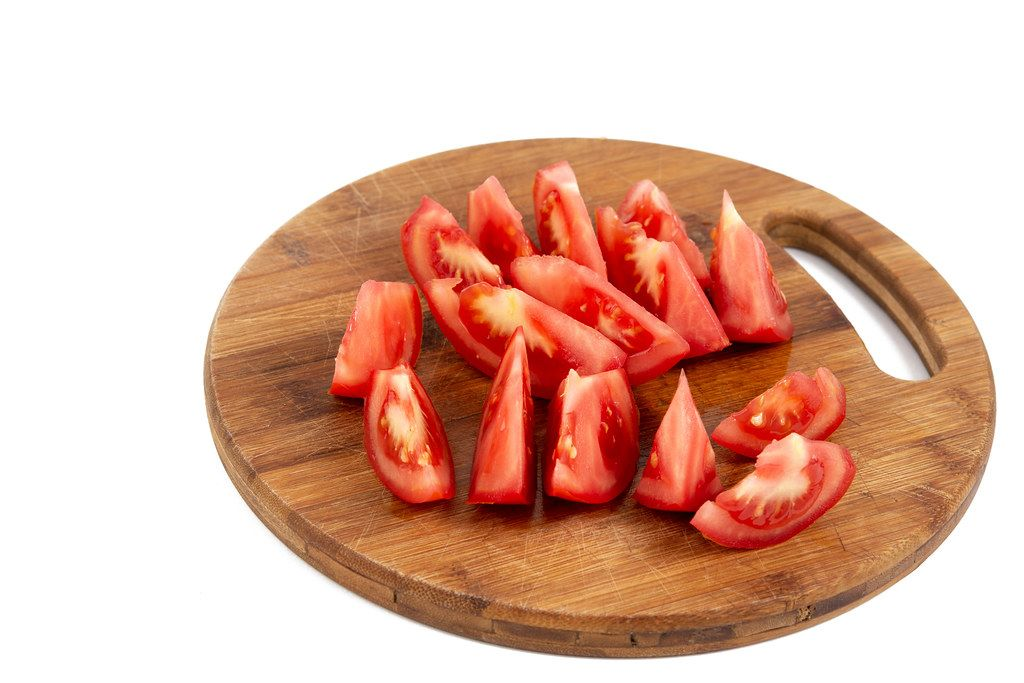 Sliced Tomato on the wooden board