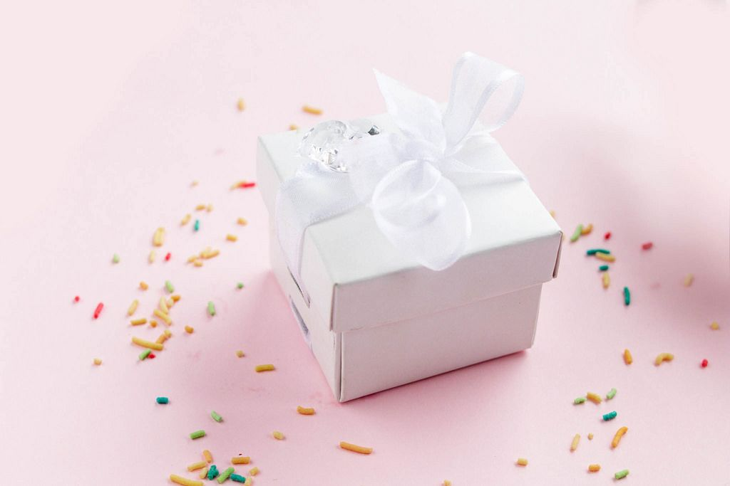 Small gift box with colorful sprinkles