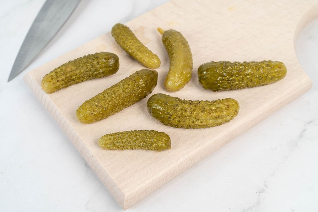 Small Pickles on the wooden board
