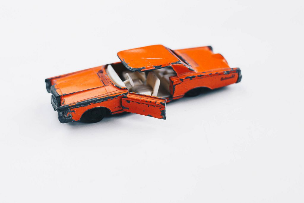 Small retro toy car on white background
