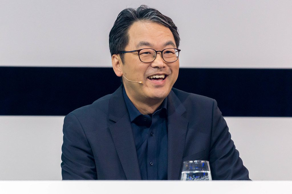 Smiling portrait of Dr. Alex Jinsung Choi, Senior Vice President of Strategy and Technology Innovation at Deutsche Telekom AG