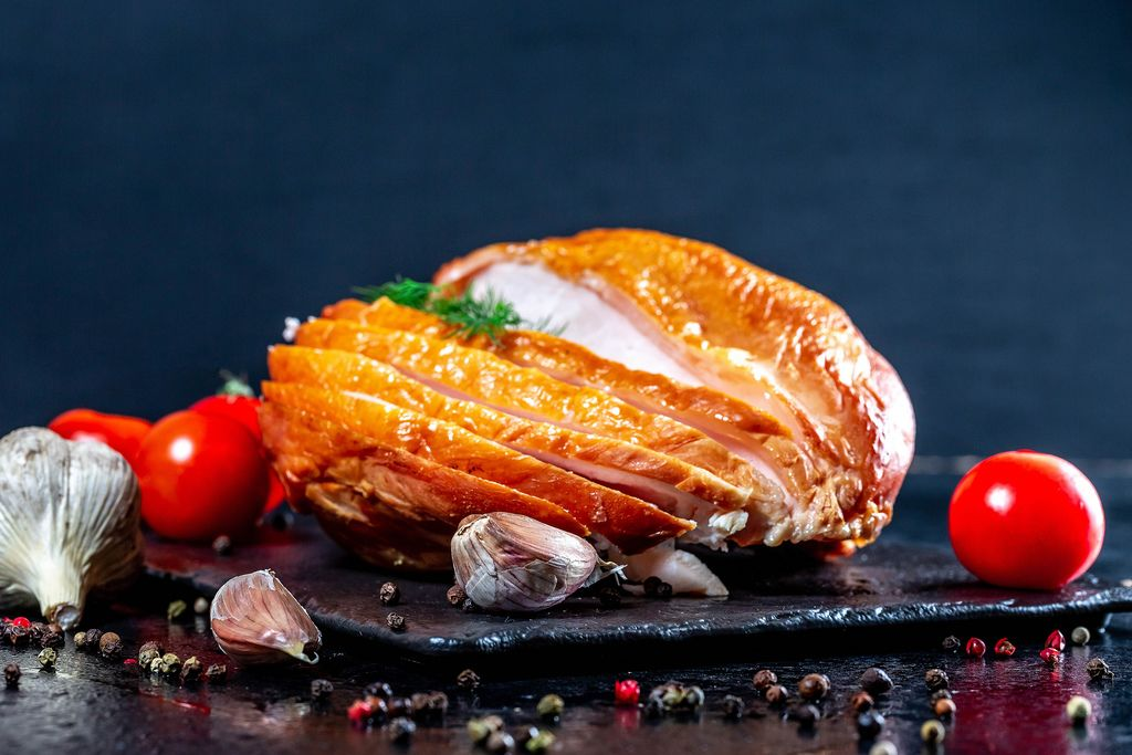 Smoked chicken breast with vegetables and spices on dark background (Flip 2019)