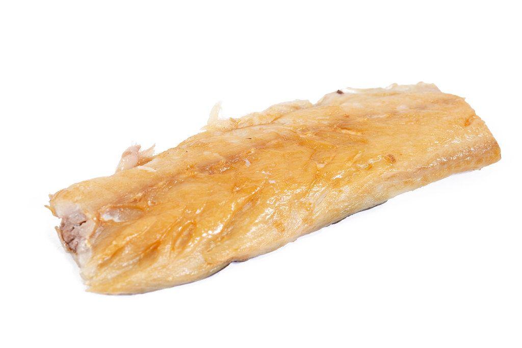 Smoked Mackerel fish isolated above white background