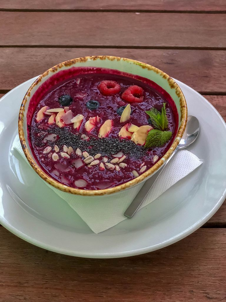 Smoothie Bowl at Avocado Cafe: bilberry, banana, beet juice, raspberry, blueberry, poppy seeds, sunflower seeds, almonds, mint