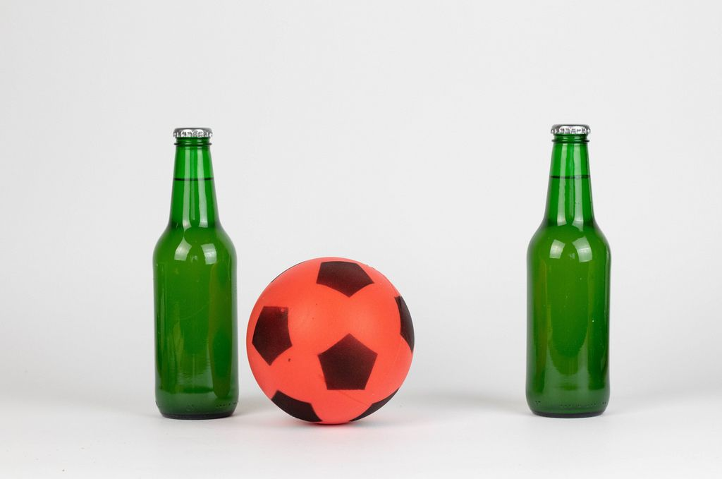 Soccer ball and beer bottles