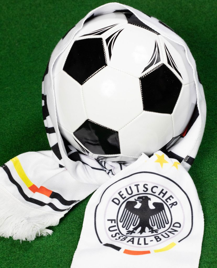 Soccer ball covered with German fan scarf