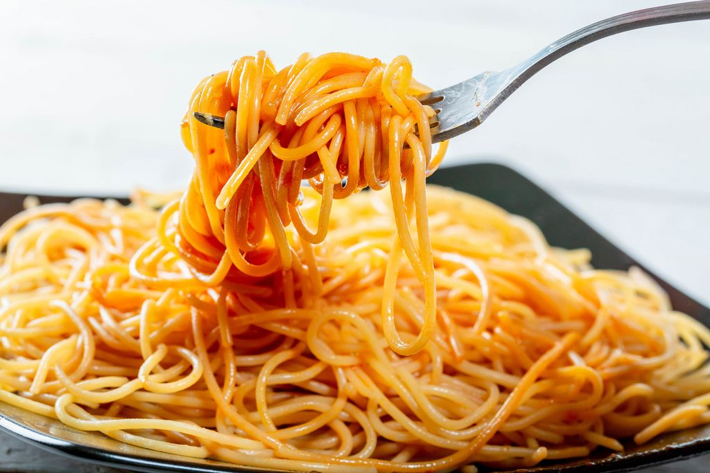 Spaghetti wound on a fork close-up