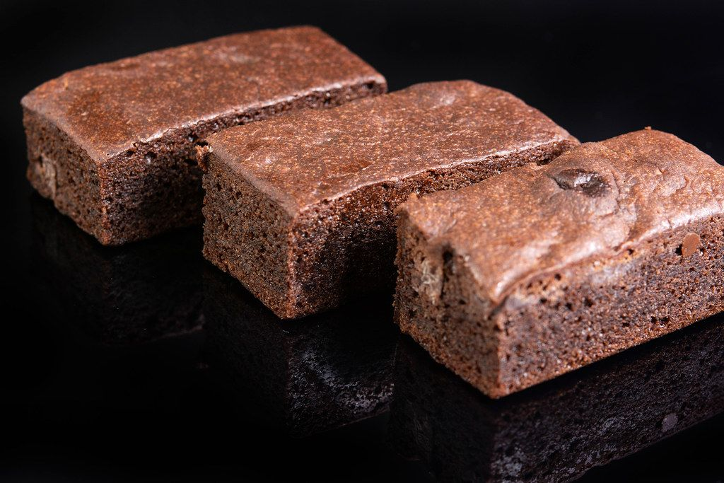 Square Chocolate Muffins on black reflective background