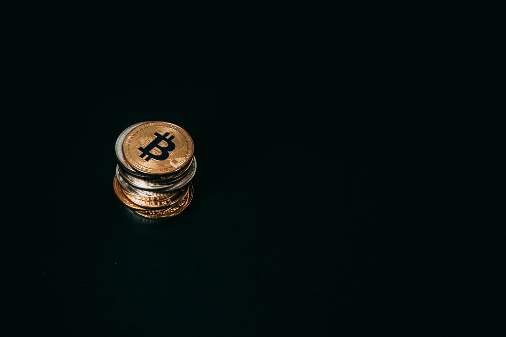 Stack of Bitcoin on black background