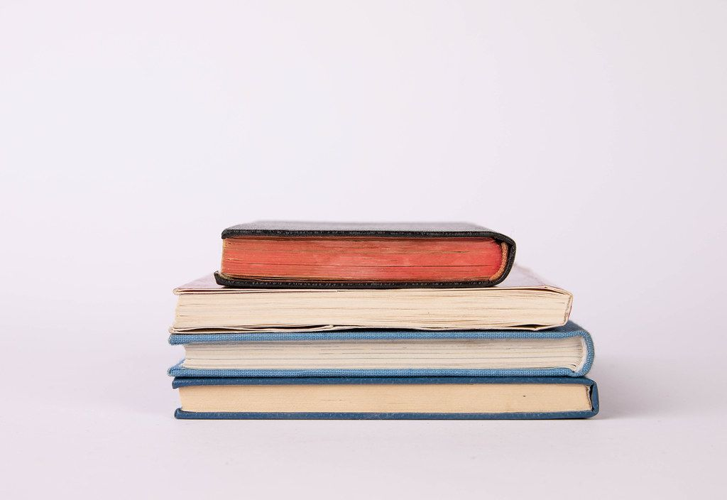 Stack of books on white background (Flip 2019)