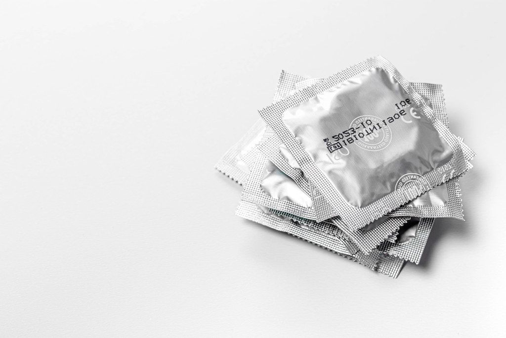 Stack of sealed condoms on a white background (Flip 2019)