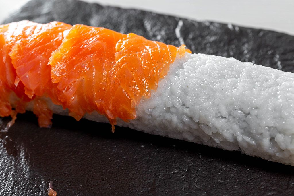 Stages of preparation of sushi rolls Philadelphia