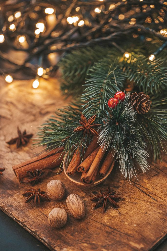 Star anise, cinnamon and nutmeg, Christmas tree branches with glowing garlands (Flip 2019)