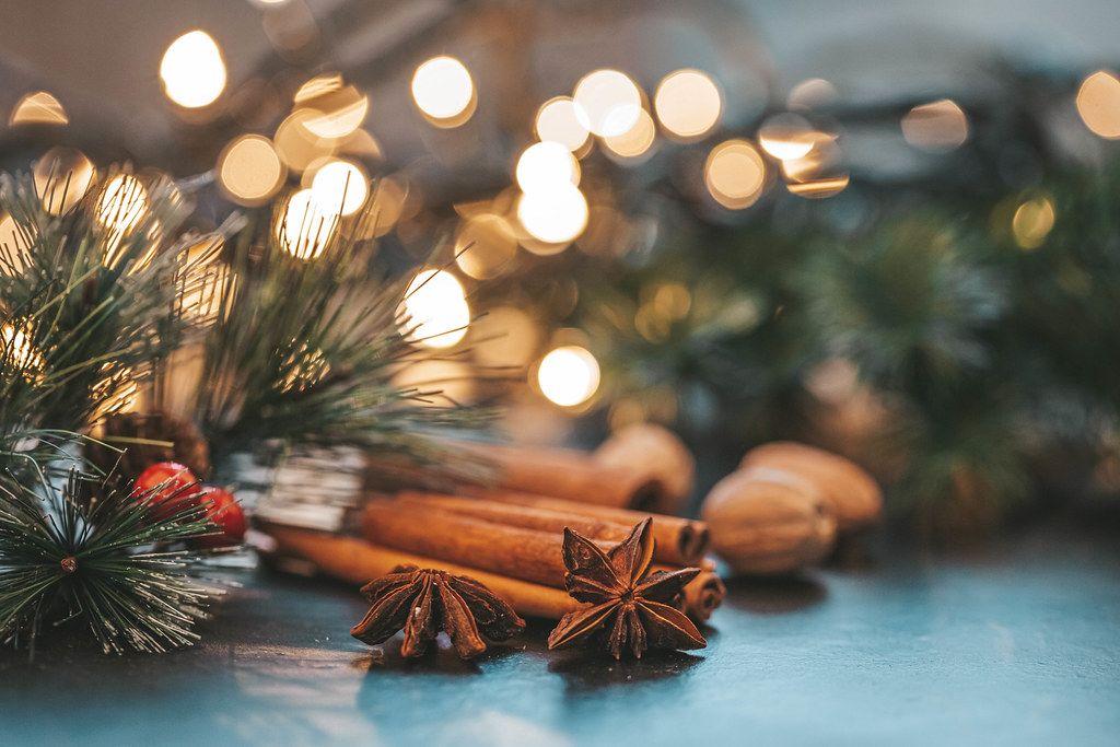 Star anise, cinnamon and nutmeg on Christmas night background with Golden bokeh (Flip 2019)