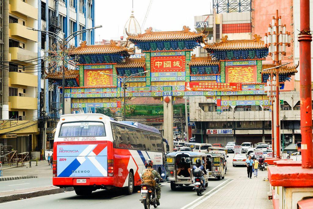 Street cars entering the Manila chinatown