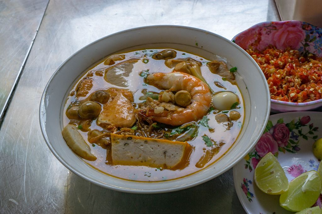 Street Food Noodle Soup with Seafood, Limes and Chili in Saigon