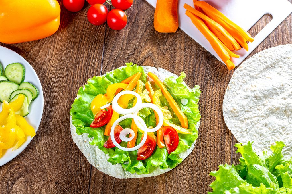 Summer ripe vegetables and pita on wooden background (Flip 2019)