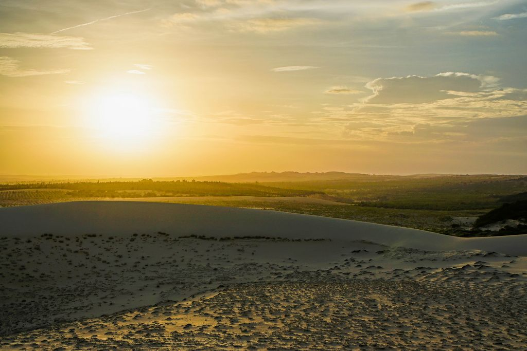 Sunset Watching from the White Sand Dunes in Mui Ne, Vietnam