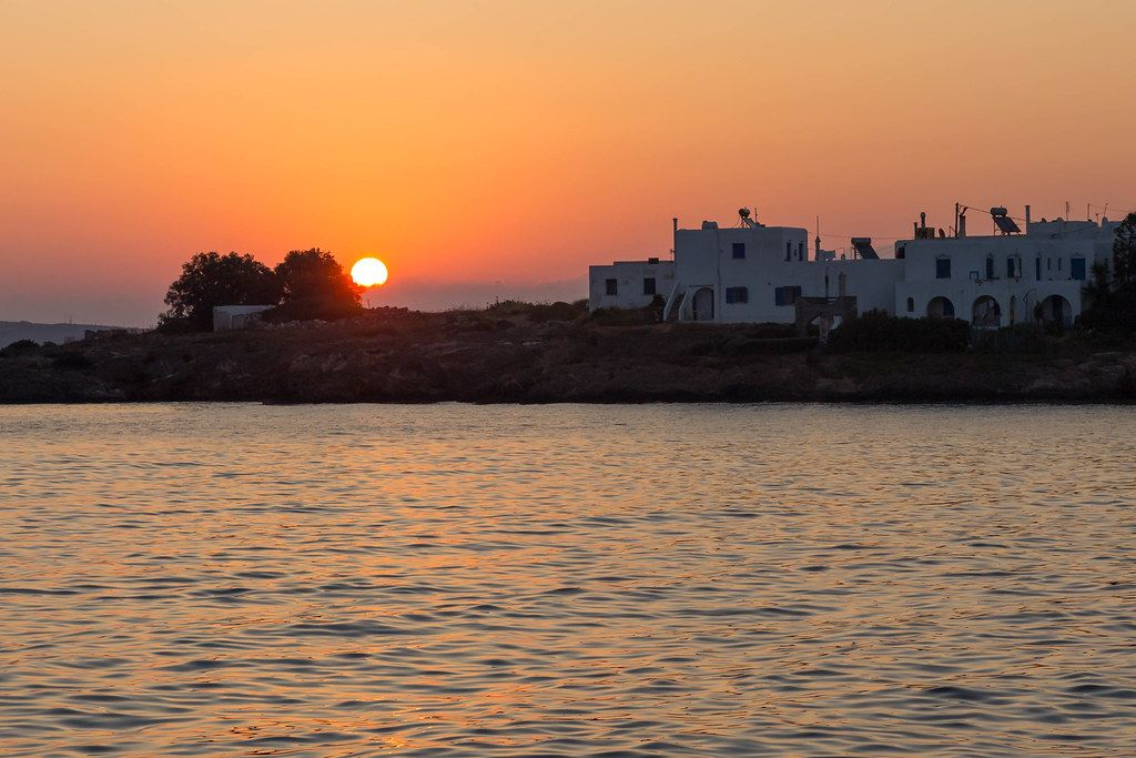 Sunset with red sky over the Greek harbour town Naousa on Paros in the Mediterranean Sea