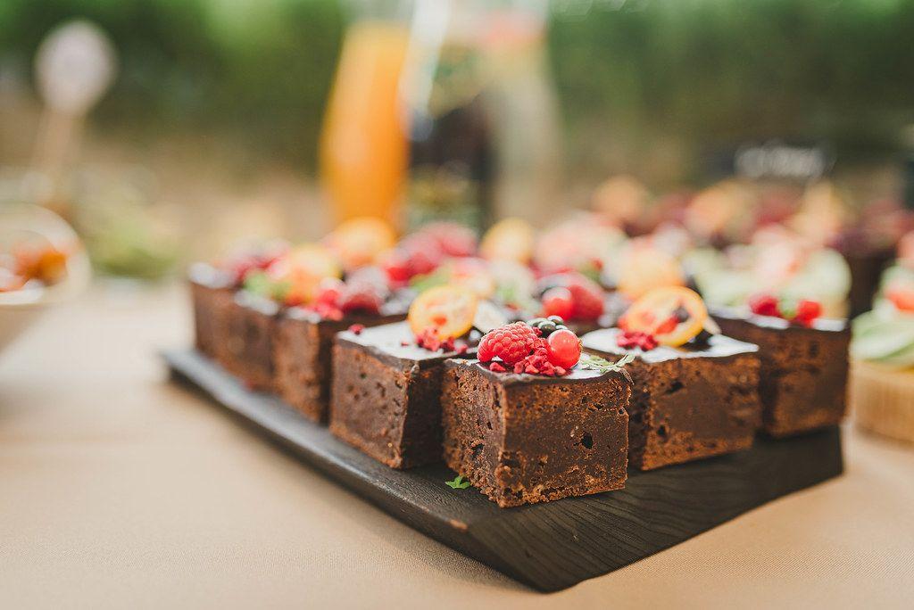 Sweet Brownie Squares With Various Berries On Top