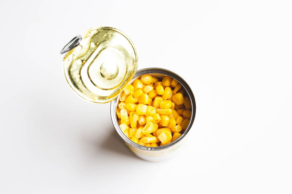 Sweet corn in a can on white background
