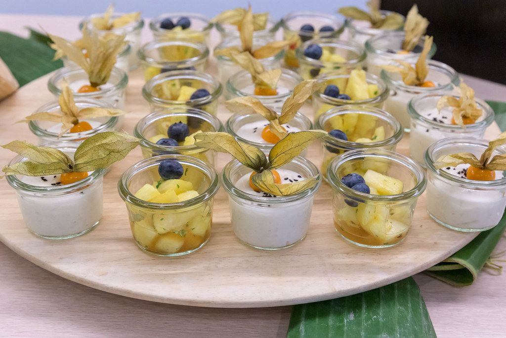 Sweet sticky rice with coconut milk and sesame & marinated pineapple, sweet and sour at the OMWest Barcamp of AXA in Cologne, Germany