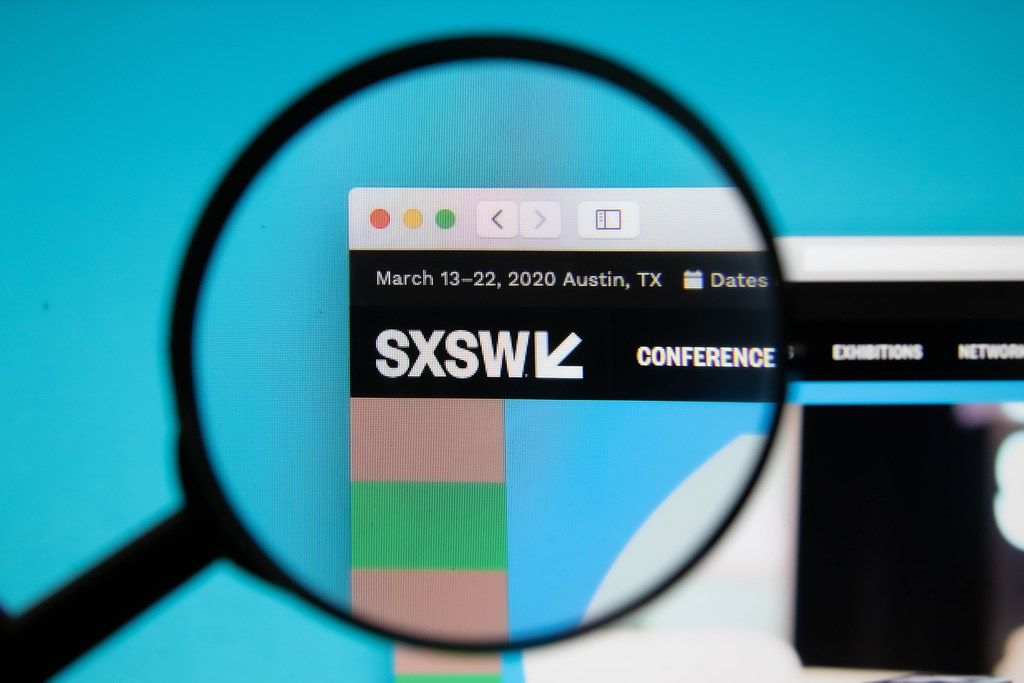 SXSW logo on a computer screen with a magnifying glass
