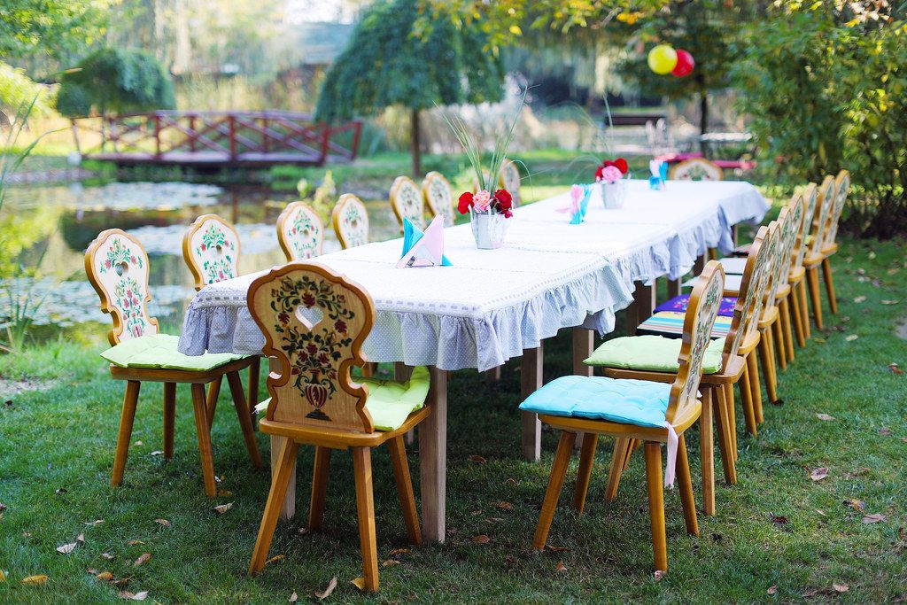 Table and chairs arranged for outdoor children party (Flip ...
