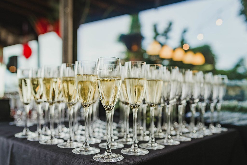 Table Of  Freshly Filled Champagne Glasses