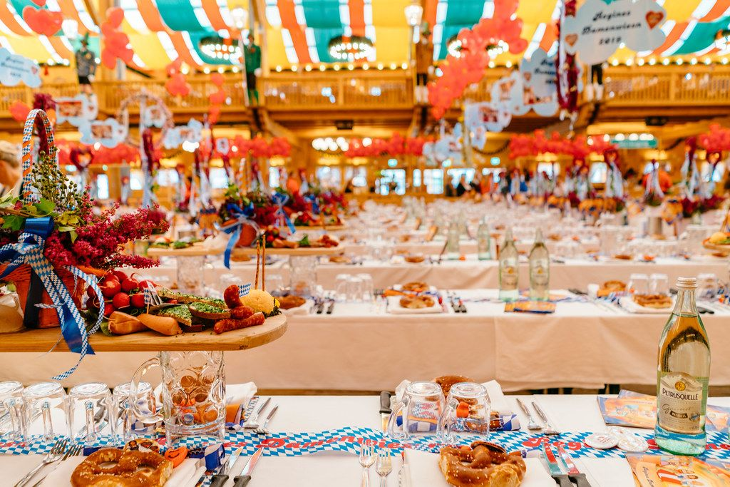 Tables served with food ready for the Oktoberfest feast to start