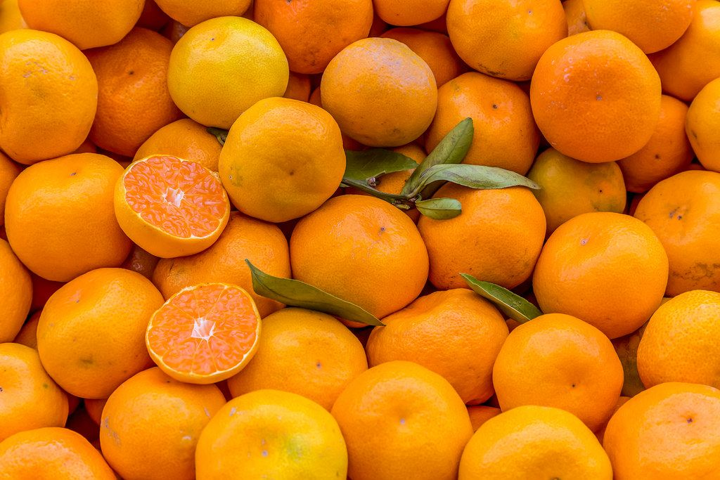 Tangerines with foliage on marketplace