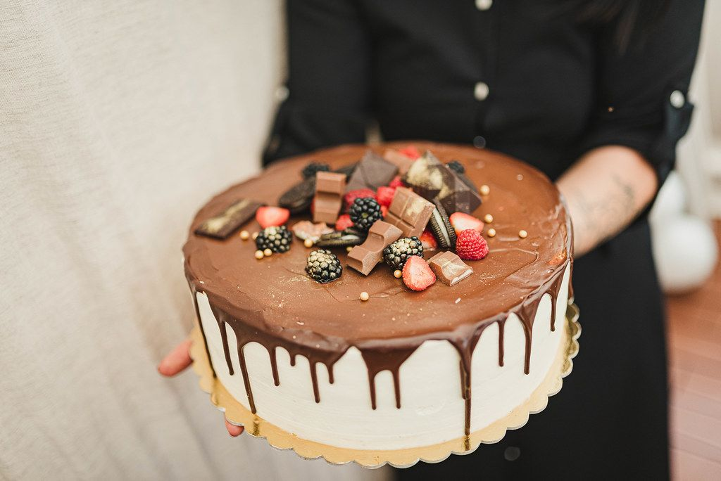 Tasty Cake With Chocolate And Berries On Top