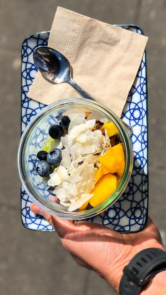 Tasty fruit salad: mango, blueberries, coconut flakes and granola