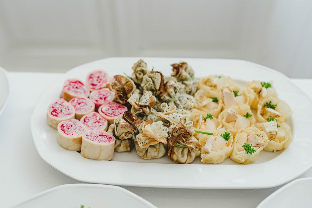 Tasty Roll Appetizers On A White Plate