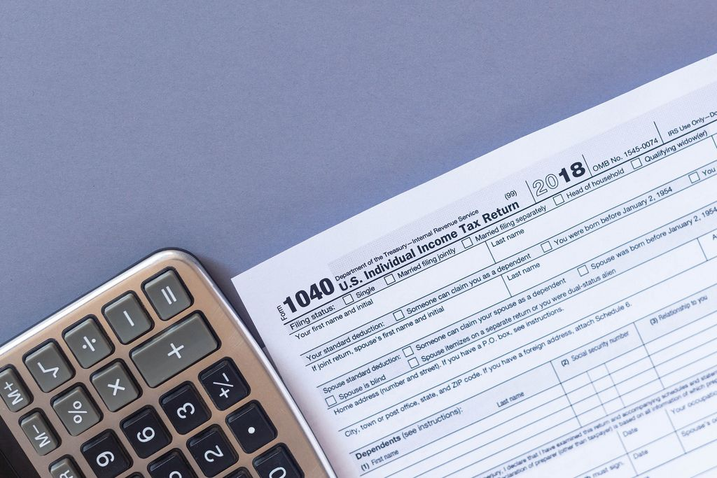 Tax form 1040 and a calculator. US tax form law document. Business concept