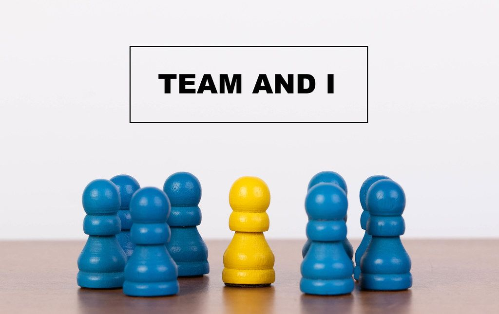 Team and I concept with pawn figurines on table