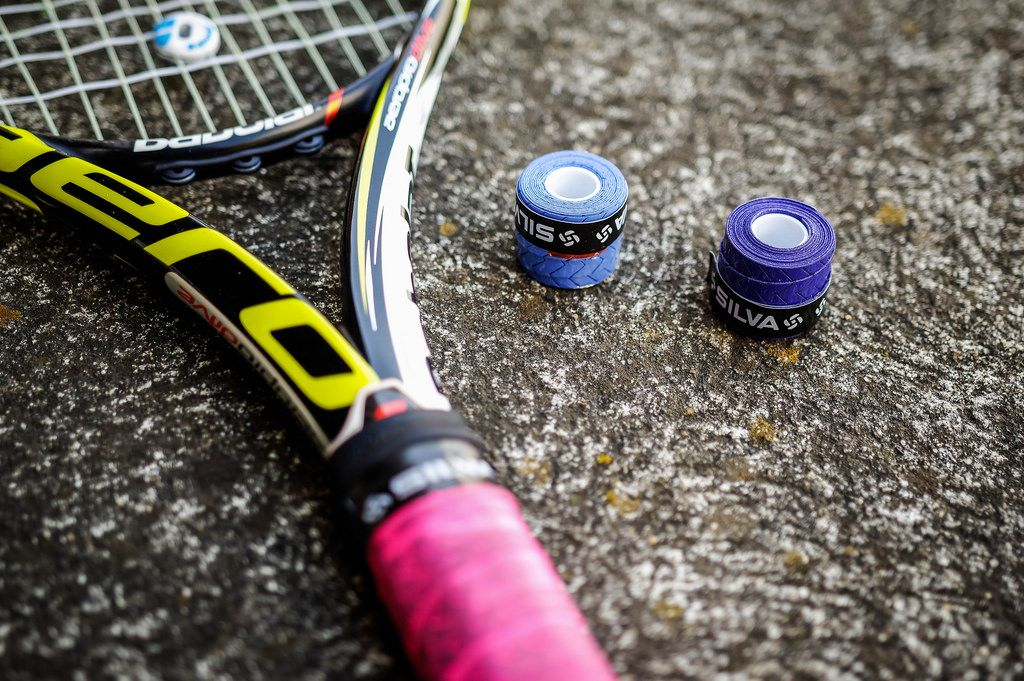 Tennis racket and over grip rolls