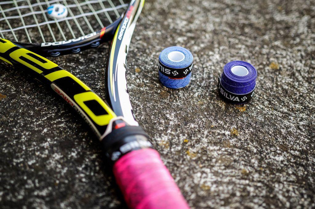 Tennis racket and over grip rolls