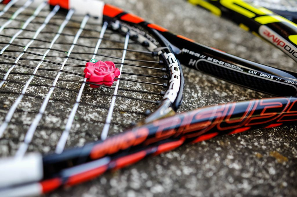 Tennis racket with a vibration dampener