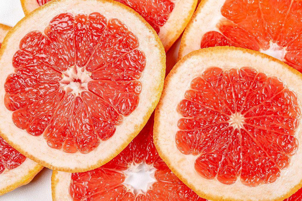 Texture of a ripe grapefruit slice, closeup