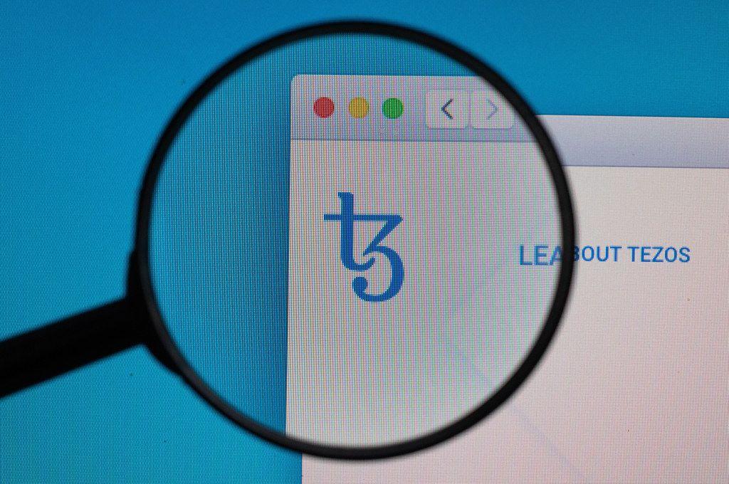 Tezos logo under magnifying glass