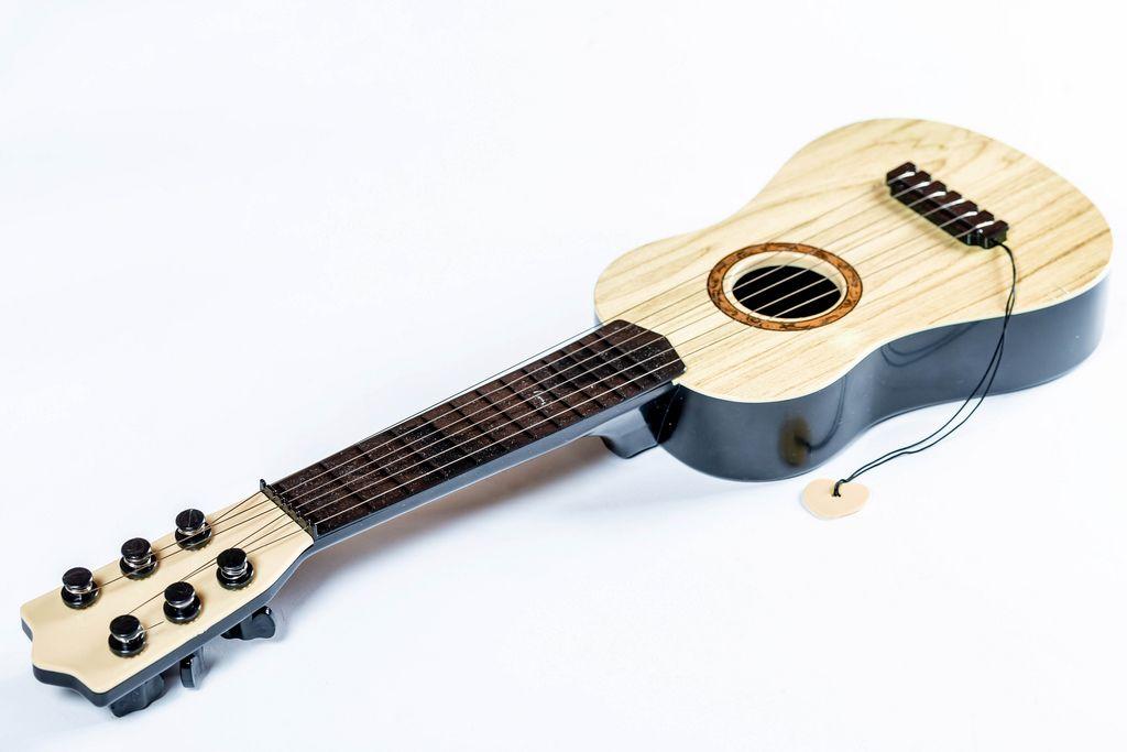 The brown guitar on the white background (Flip 2019) (Flip 2019) Flip 2019