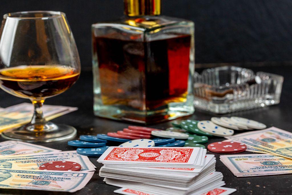 The concept of men's rest - cognac, cards, chips, money and cigarette