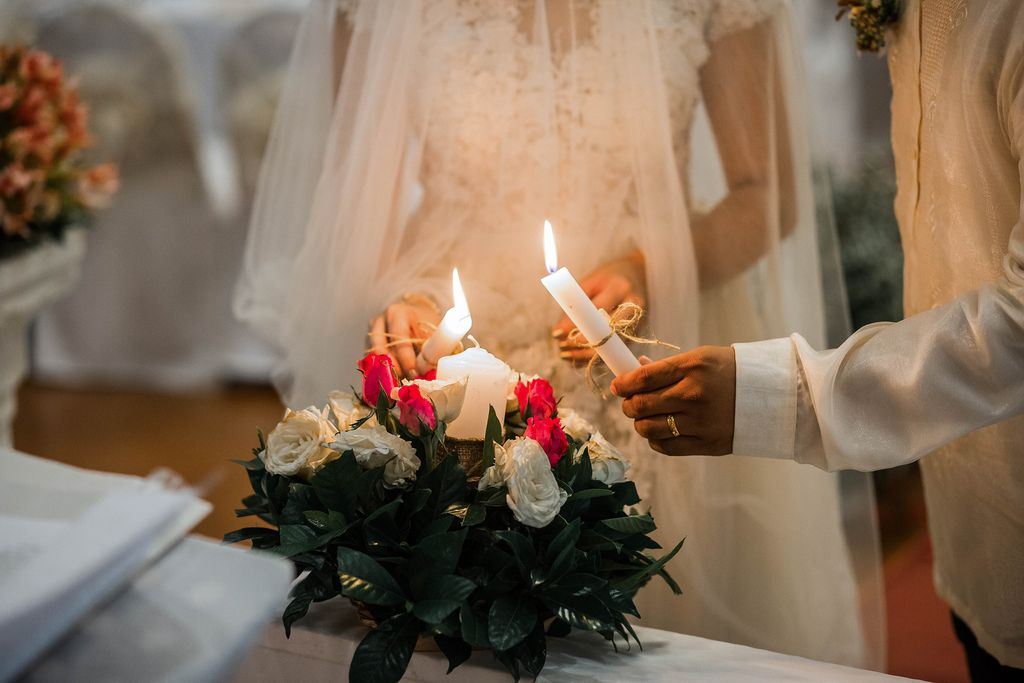The couple lighting a unity candle at a wedding (Flip 2019) (Flip 2019) Flip 2019