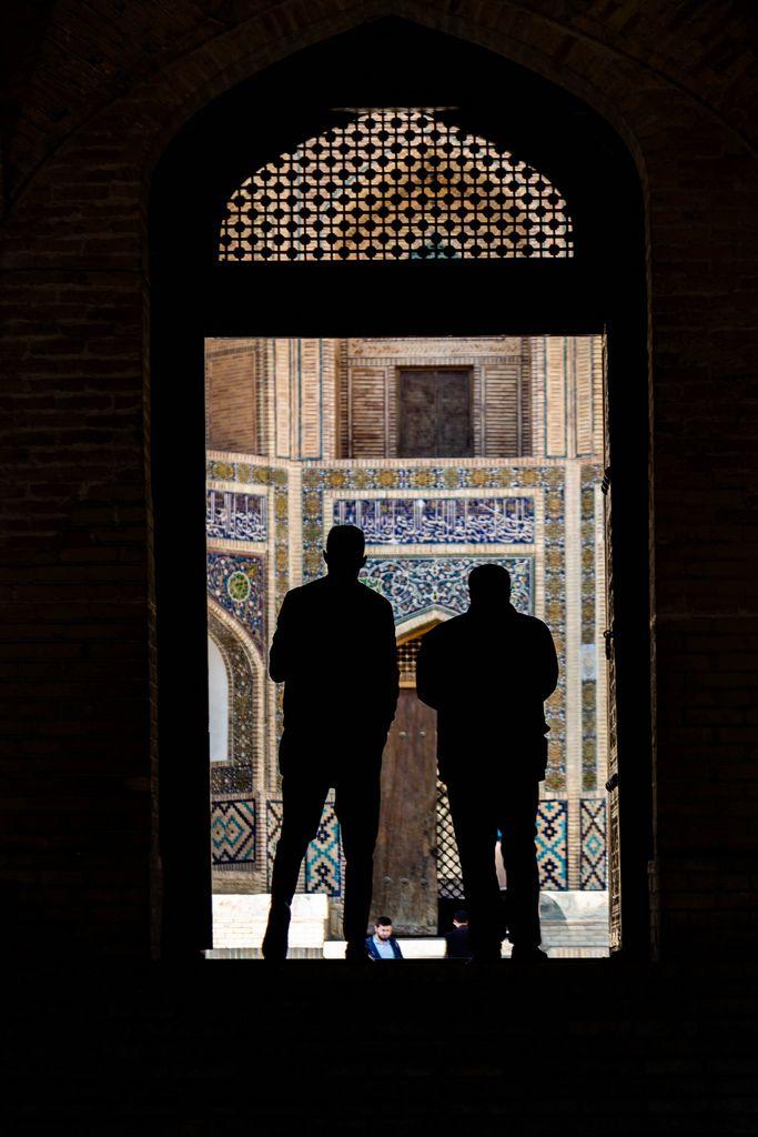 The Mir-i-arab Madrassah seen beyond the doors of the Kalon Mosque, Bukhara, Uzbekistan (Flip 2019)