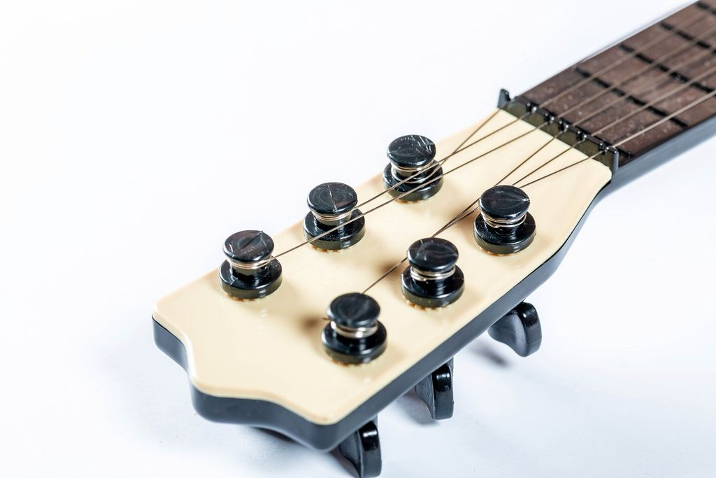 The neck of the guitar with strained strings