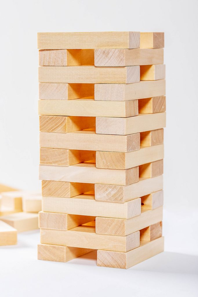 The tower is built with wooden parts of the game Jenga