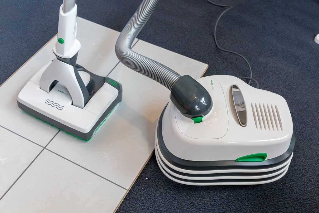 The vacuum squeegee Kobold VT300 & SP600 cleans dog hair on tiles and is presented at the pet fair 2019 in Cologne, Germany