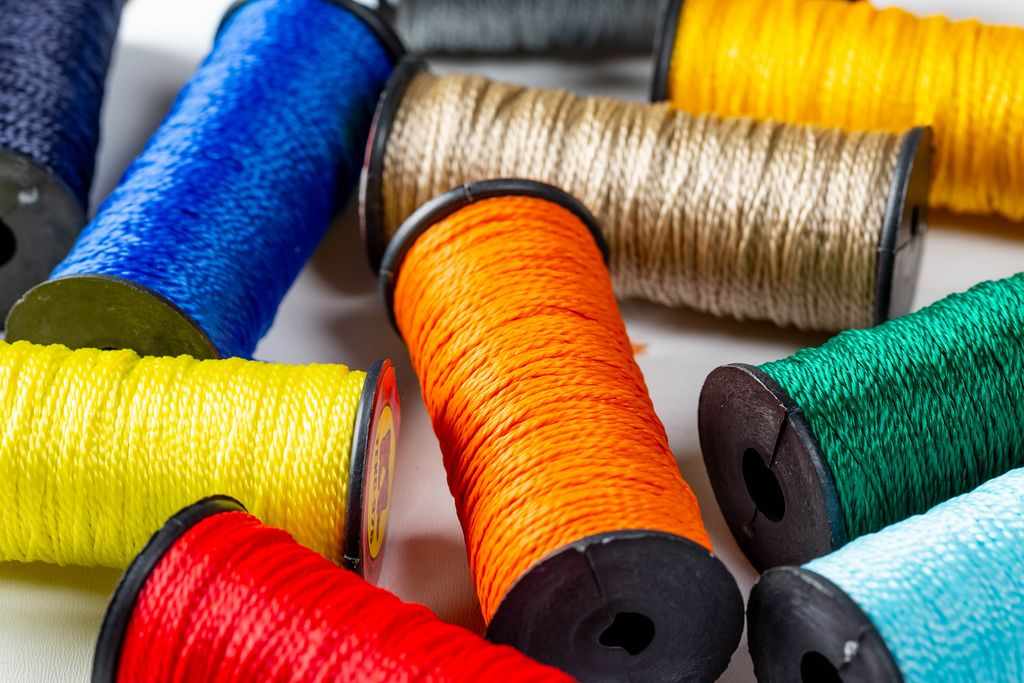 Threads for sewing of different colors