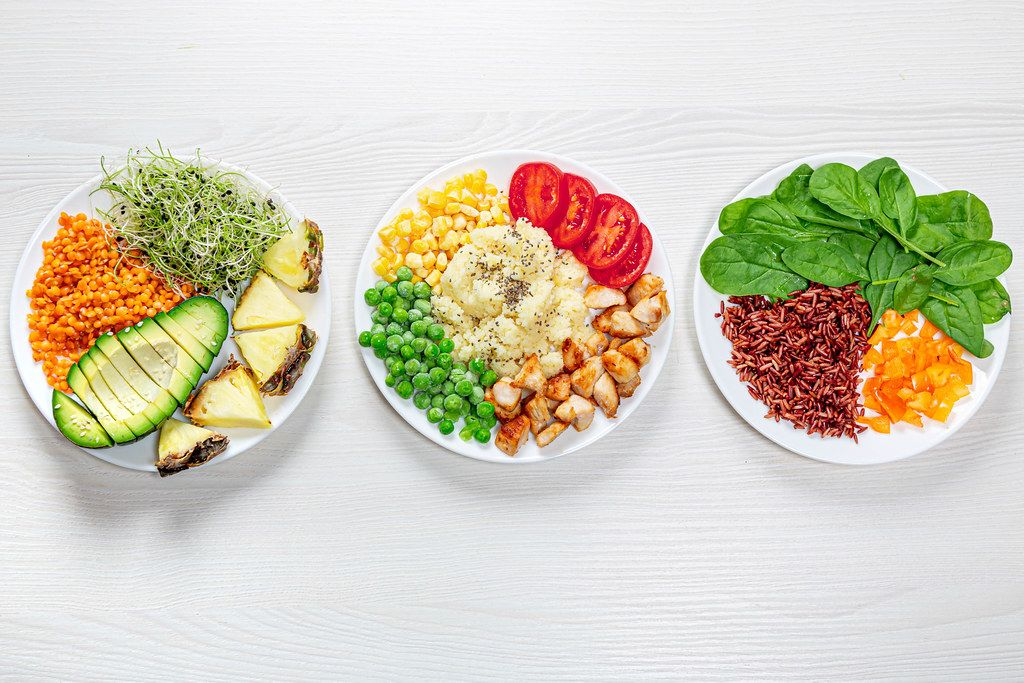 Three variants of diet lunch on a white wooden background. Top view